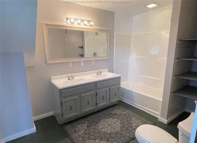 Bathroom featured at 1321 Maccorkle Ave SE, Charleston, WV 25314