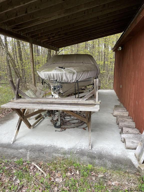Porch yard featured at 333 Bunker Hill Rd, Mayfield, NY 12117