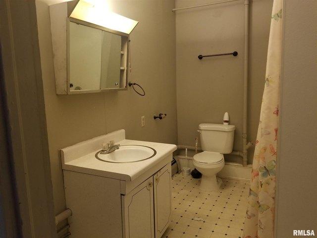 Bathroom featured at 149 E Jackson St, Virden, IL 62690