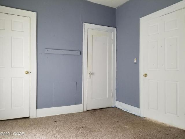 Bedroom featured at 1521 S Connor Ave, Joplin, MO 64804