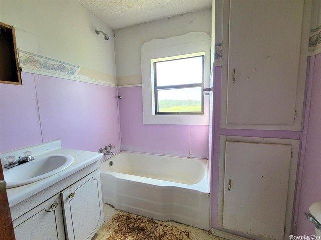 Bathroom featured at 837 Polk Road 1, Grannis, AR 71944
