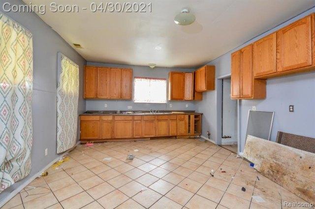 Kitchen featured at 171 Court St, Mount Clemens, MI 48043