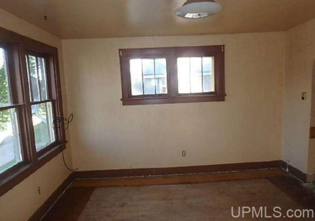 Bedroom featured at 227 Amber St, Iron River, MI 49935