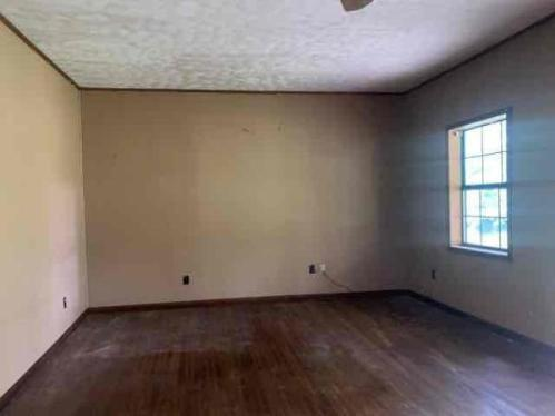 Bedroom featured at 31 County Road 267, Bruce, MS 38915