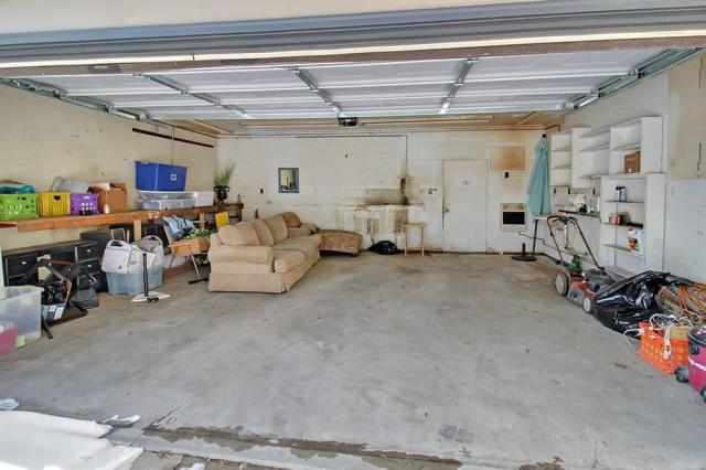Garage featured at 414 N 24th St, Parsons, KS 67357