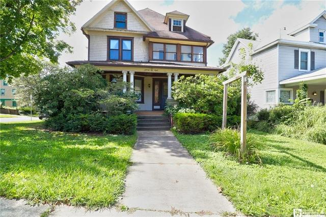 Porch yard featured at 98 Forest Ave, Jamestown, NY 14701
