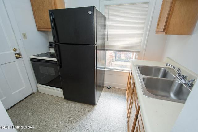 Laundry room featured at 3520 Herman St, Louisville, KY 40212
