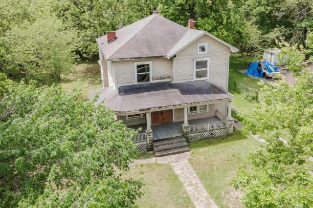 House view featured at 2415 Columbus St, Muskogee, OK 74401