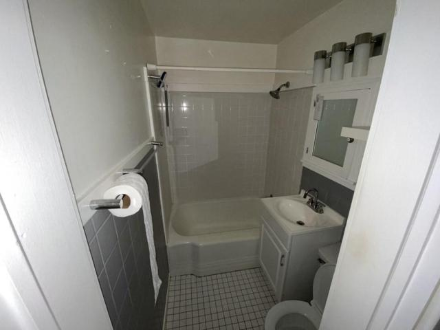 Bathroom featured at 118 W Forest St, Pittsburg, KS 66762