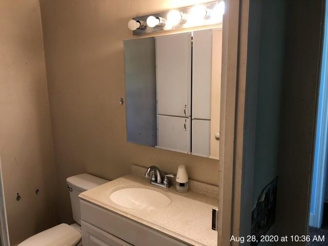 Bathroom featured at 335 Colorado St, Avery, TX 75554