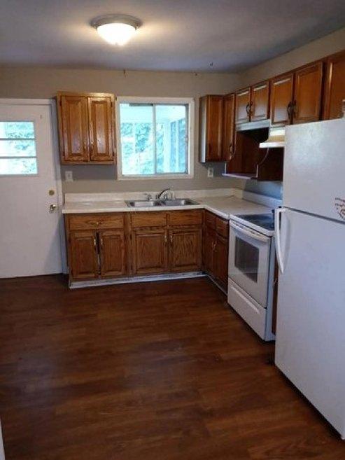 Kitchen featured at 1097 Glacier St, Grundy, VA 24614