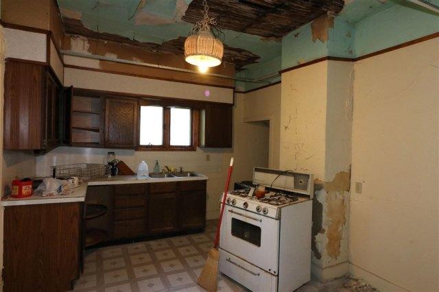 Kitchen featured at 101 E High St, Linn Grove, IA 51033
