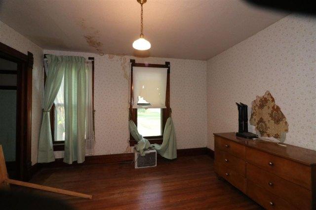 Bedroom featured at 101 E High St, Linn Grove, IA 51033
