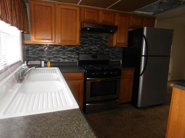 Kitchen featured at 64 Parkway Dr, Williamson, WV 25661