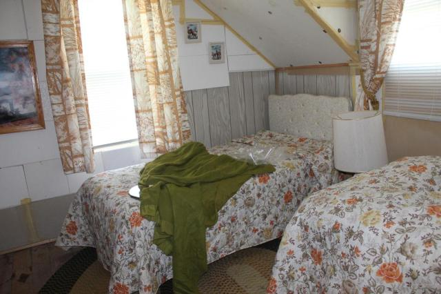 Bedroom featured at 75 Fairfield St, Island Falls, ME 04747