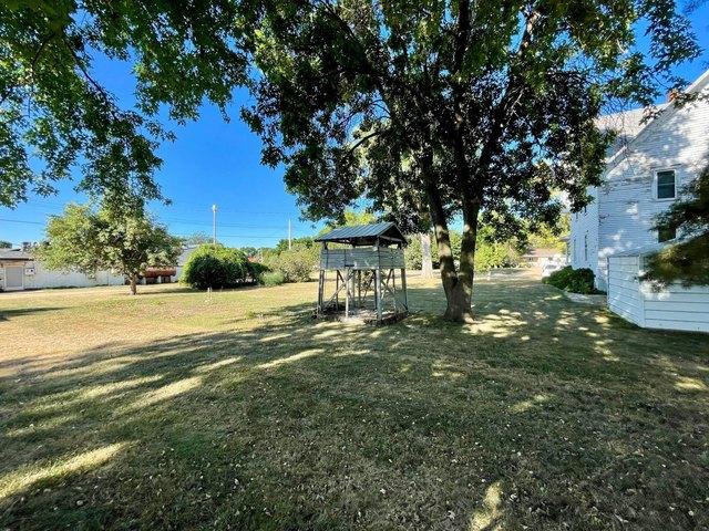 Road view featured at 115 N Oak St, Wanda, MN 56294
