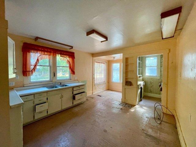 Kitchen featured at 115 N Oak St, Wanda, MN 56294
