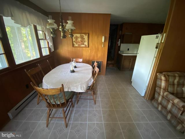 Dining room featured at 20728 S Fork Rd, Moorefield, WV 26838