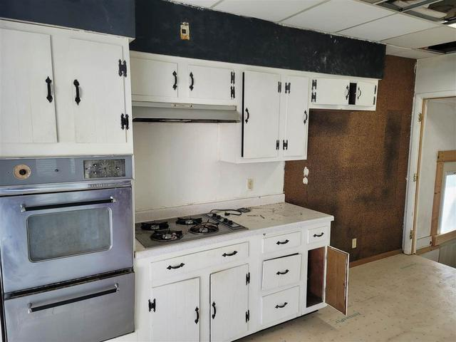 Kitchen featured at 1220 W 3rd St, Waterloo, IA 50701