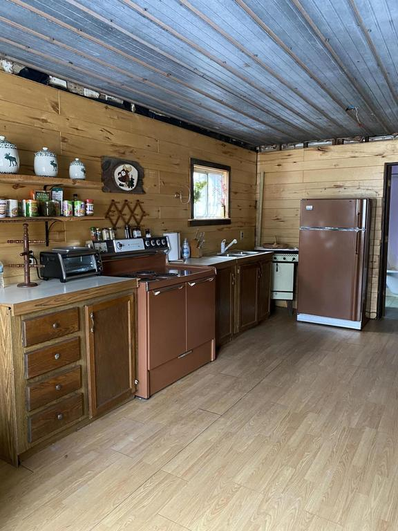 Kitchen featured at 31730 W H 40, Trout Lake, MI 49793
