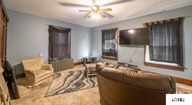 Living room featured at 213 N Bogardus St, Elkhart, IL 62634
