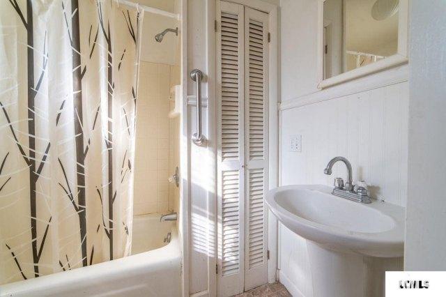 Bathroom featured at 213 N Bogardus St, Elkhart, IL 62634