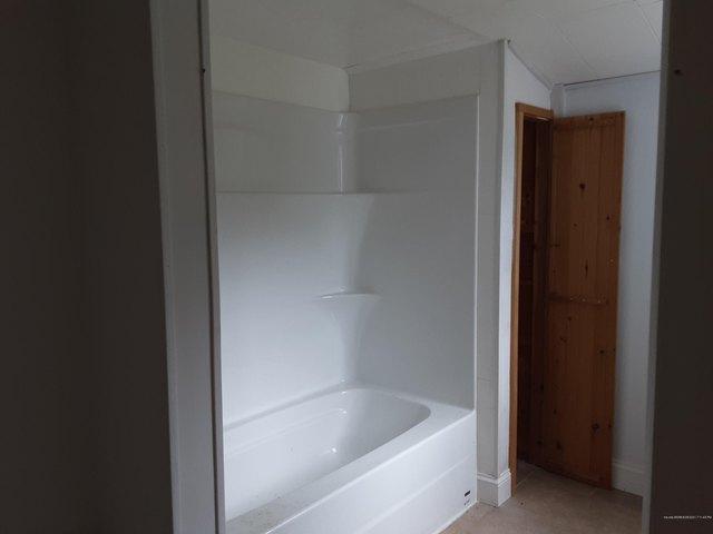 Bathroom featured at 11 Elm St, Houlton, ME 04730