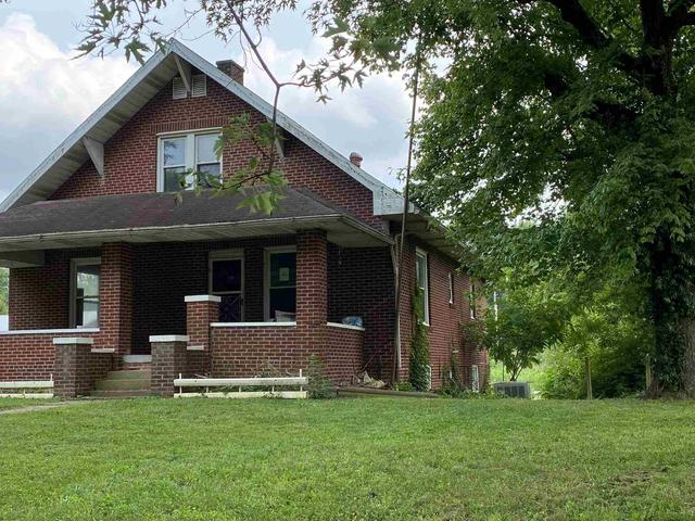 Porch yard featured at 1104 E 5th St, Spurgeon, IN 47584