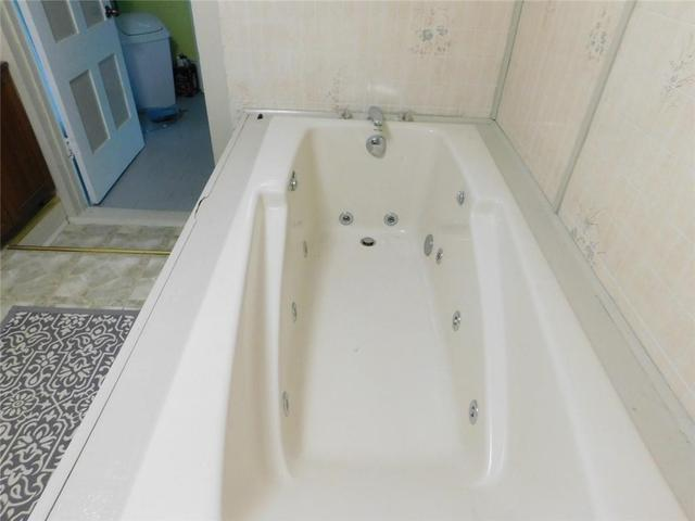 Bathroom featured at 16 S Main St, Cohocton, NY 14826