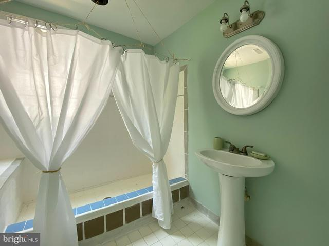 Bathroom featured at 4017 Tyler Rd, Ewell, MD 21824