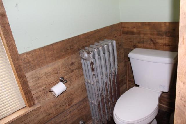 Bathroom featured at 38 Success St, Berlin, NH 03570