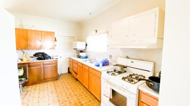 Kitchen featured at 600 N Main St, Columbus, ND 58727