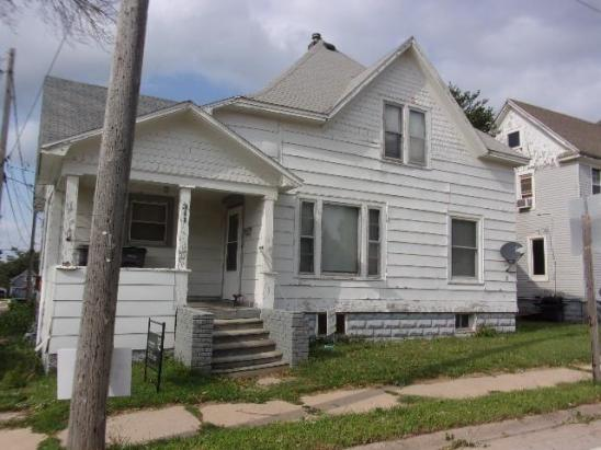 Porch featured at 311 E Charles St, Oelwein, IA 50662