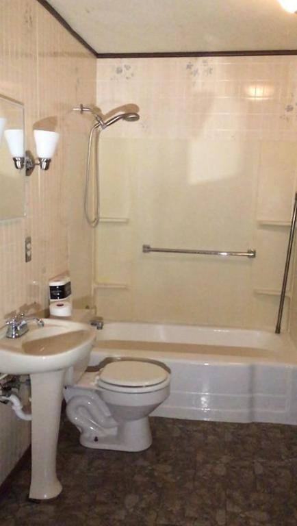 Bathroom featured at 1031 Monroe St, Great Bend, KS 67530