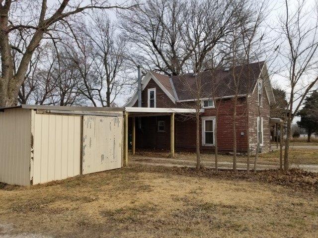 Porch yard featured at 408 N Locust St, Grenola, KS 67346