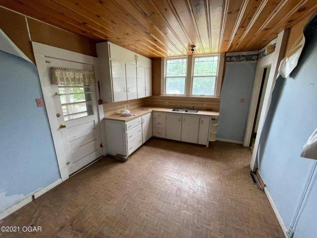 Kitchen featured at 406 E 9th St, Baxter Springs, KS 66713