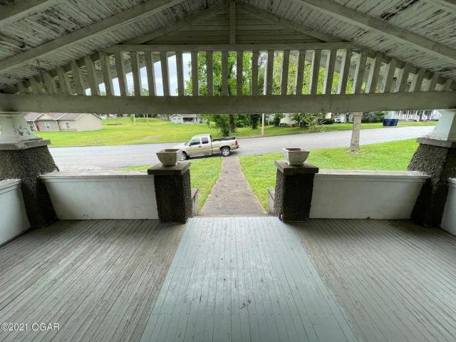 Porch featured at 406 E 9th St, Baxter Springs, KS 66713