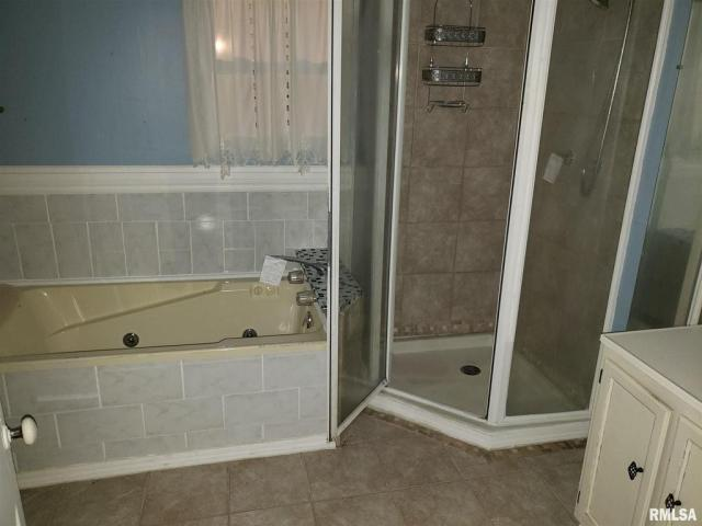 Bathroom featured at 802 S Cleveland Ave, Springfield, IL 62704