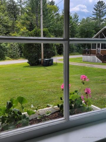 Porch yard featured at 3 Perch Rd, Madison, ME 04950
