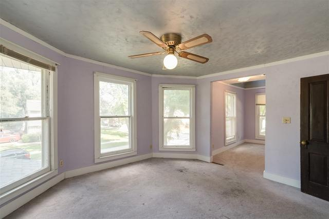 Bedroom featured at 901 W Taylor St, Bloomington, IL 61701