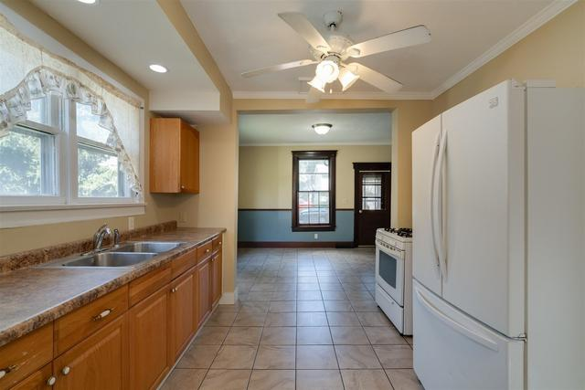 Kitchen featured at 901 W Taylor St, Bloomington, IL 61701