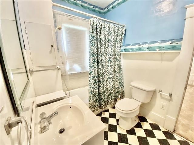 Bathroom featured at 100 N 2nd St, Elmo, MO 64445