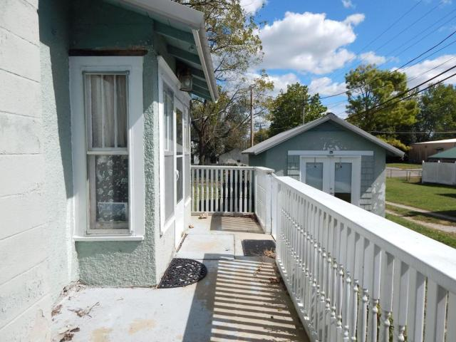 Porch featured at 214 and 216 N Greene Ave, Mountain Grove, MO 65711