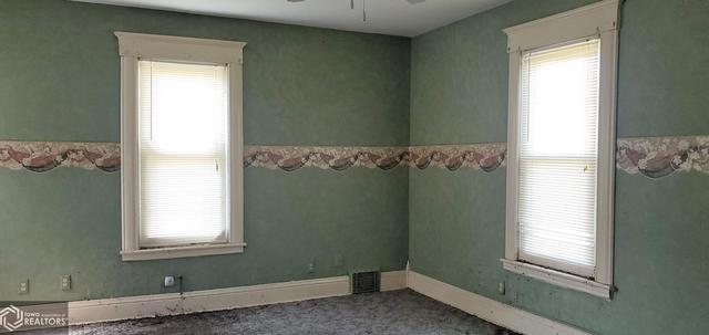 Bedroom featured at 301 Depot St, Promise City, IA 52583