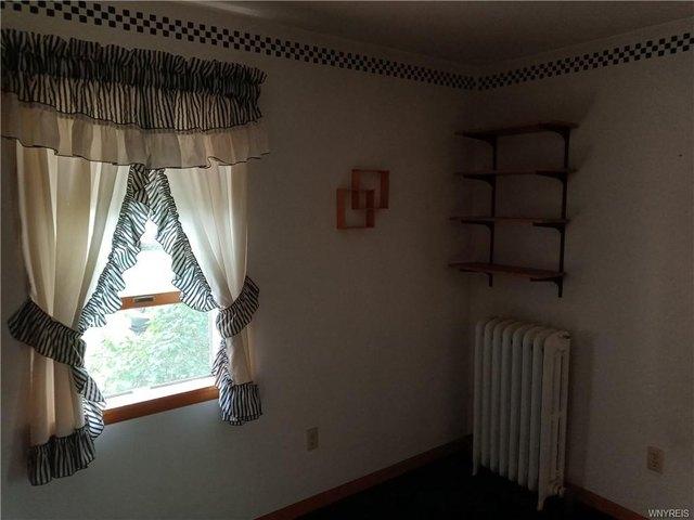 Bedroom featured at 107 Elizabeth St, Medina, NY 14103