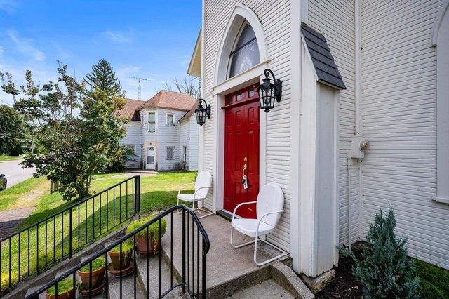 Porch yard featured at 209 E Church St, Lynn, IN 47355