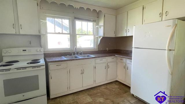 Kitchen featured at 210 McNary St, Campbellsville, KY 42718