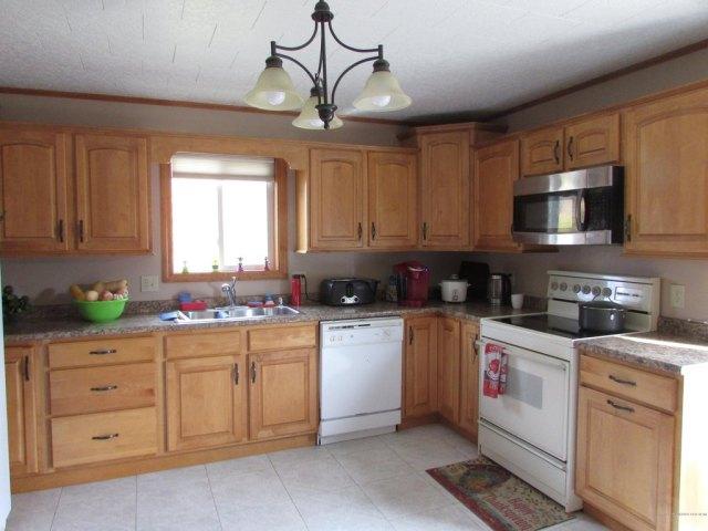 Kitchen featured at 14 Kelleran St, Houlton, ME 04730