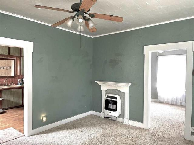 Laundry room featured at 115 S Ash St, Ponca City, OK 74601