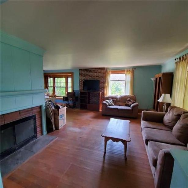 Living room featured at 11993 Butler St, Wolcott, NY 14590